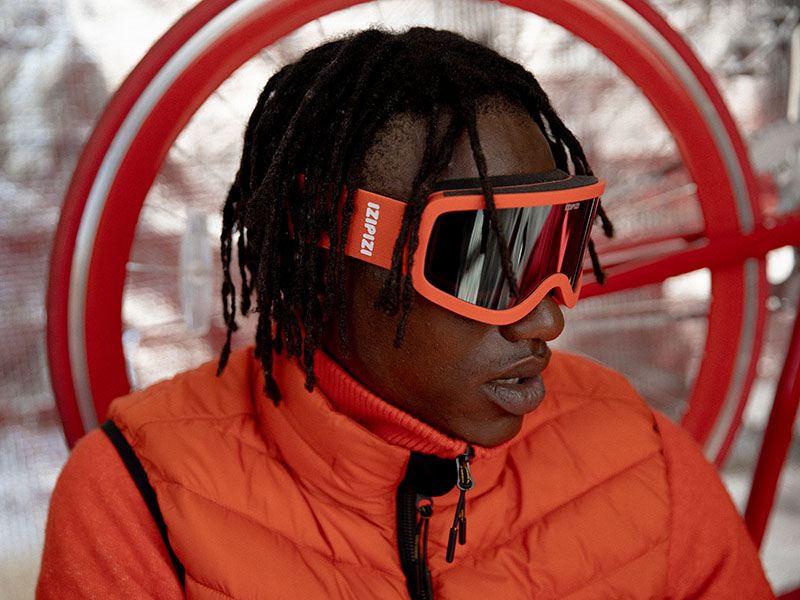 Nightingale-izipizi_nationalgeographic_fall_winter_2020_red_ski_glasses_red_puffer_menswear