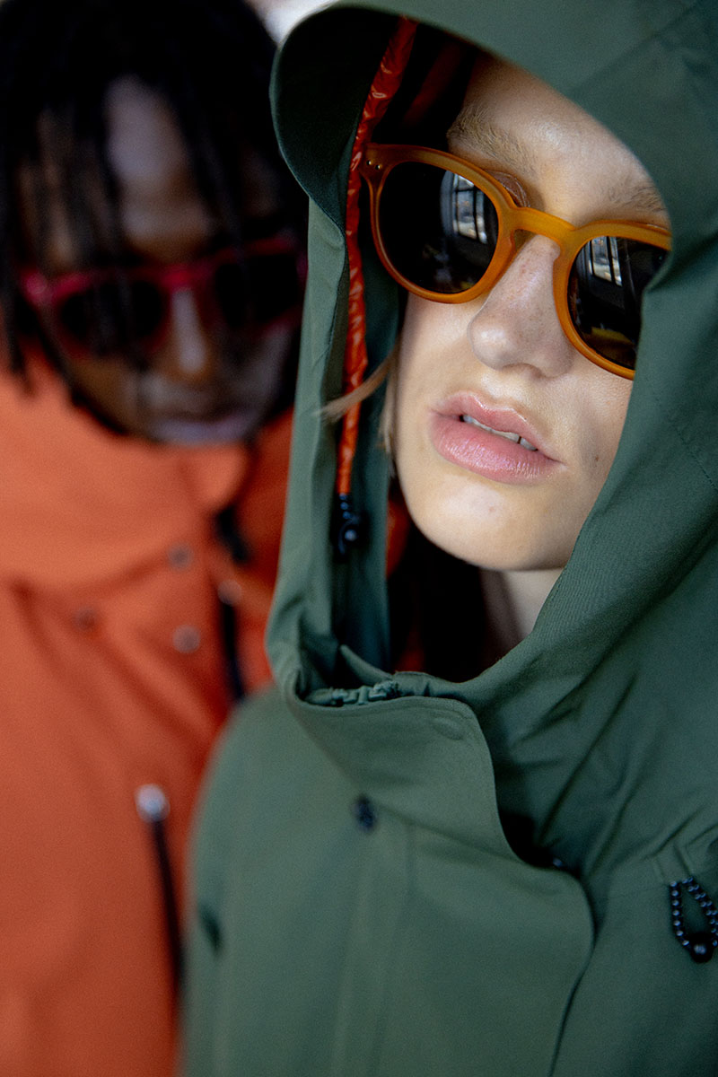 Nightingale-savetheduck-izipizi_fall_winter_2020_green_jacket_orange_glasses
